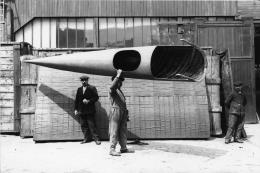 Workman in 1912 carrying a complete Deperdussin monocoque fuselage at the Deperdussin factory in Paris