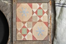 Unique and charming.. protect your surfaces with a reclaimed wood and tile pot stand, £60, at Maitland & Poate