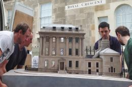 Carrying the model of No1 Royal Crescent into the museum