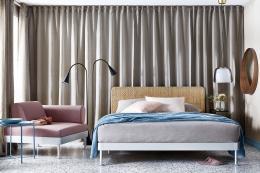 Delaktig bed with rattan headboard