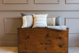 Linen cushions in neutral tones by Liverpool's Linen & Stripes