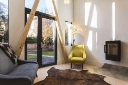 The 4m high rear sitting room does have a wood burning stove as a little luxury for winter