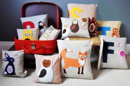 Fun eco cushions for children from recycled textile designer Laura Ann Marsden's Lettie Belle brand, prices from £30. www.lettiebelle.com