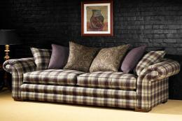 Raffles sofa with solid hardwood frame (from £3,100), by Long Eaton-based Peter Guild. www.peterguild.co.uk