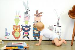 US brand Pop & Lolli makes recyclable, repositionable fabric decals, great for nurseries. £52 plus shipping