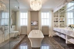 Master bathroom with bespoke chandelier and acres of carrara marble. A more eco alternative is to use porcelain tiles