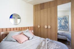 Natural wood wardrobes give a relaxed healthy air to the bedroom