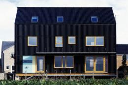 The Black House in Cambridgeshire is Bowles' own eco house, built in '04. Cladding is Eternit profile 6 cement fibre corrugated cladding painted black, emulating local vernacular barns