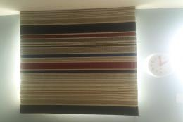 For a small window, choose a fabulous fabric for a Roman blind - such as the Paul Smith stripe chosen here