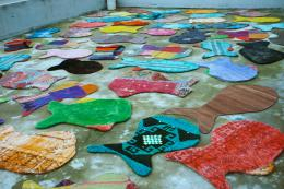 Useable areas of worn-out carpets are cut out into a fish shape to make fun rugs, ideal for children's rooms. www.bereket-unlimited.com
