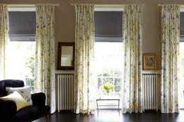 Roman blinds and curtains work well together. Products made by Hillarys, www.hillarys.co.uk