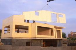 A house being assembled with Egoin's prefabricated cross-laminated timber panels