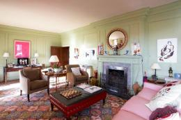Pale green walls contrast appealingly with pink upholstery