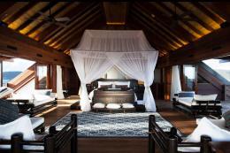 The master bedroom features dark woods