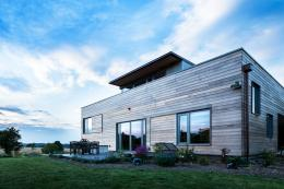 Stackyard, a private house by Mole Architects in Palgrave, Suffolk. It has a timber frame and silvered timber cladding