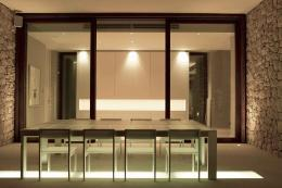 Floor to ceiling folding glass doors have been used