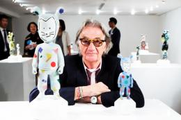 Sir Paul Smith with the Guest figurines he decorated for Jaime Hayón and Lladró