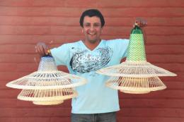 Weaver Raul Briones in Chimbarongo, Chile, with his tiered lamps