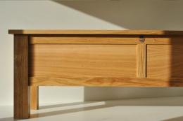 Simple and modern, a low oak bench seat/coffee table