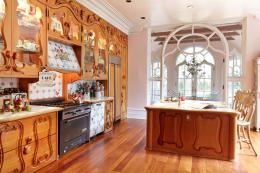 The hand-carved kitchen is made from reclaimed timber. It took a year to make