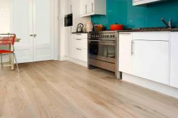 Grey tinted white engineered oak floor from The Natural Wood Floor Company, www.naturalwoodfloor.co.uk. Its widest planks are engineered 240mm