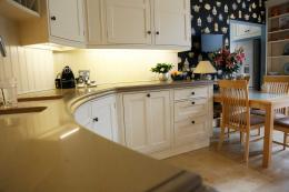 This traditional kitchen has a curved frontage