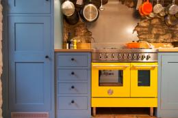 A vibrant yellow range cooker gives this country kitchen a funky vibe..the kitchen was build by Sustainable Kitchens of Bristol