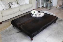 London Cows' smart flat black cow hide stool, from £400. Hides from Colombia, product is made in the UK. www.londoncows.com