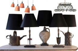 Garden tools and bric a brac are bases for lamps. Antiques By Design