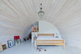 Bedroom in Hawthbush, barrel vaulted extension to a listed farmhouse in Sussex
