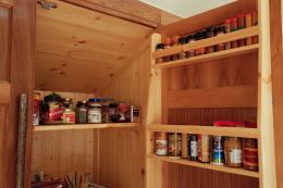 Cupboard interiors are wood