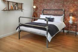 Old scaffold poles become the William bed frame from Norfolk's Wrought Iron & Brass Bed Company. www.wroughtironandbrassbed.co.uk