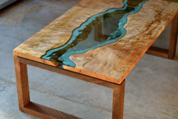 Greg Klassen is a furniture maker on the US west coast who uses fallen trees for his River Collection of tables that have clear glass running through them. Very expensive...around from £5,000 for a coffee table. Alas they're not shipped to the UK..yet..