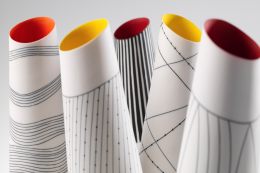 Porcelain pots with interior colours and line designs on the outside by Lara Scobie