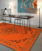 Belgian rug maker Louis De Poortere's new Vintage Collection juxtaposes acid bright colours with trad designs. Wool/cotton chenille. From £67.50