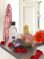 Beautiful fragrance lamps by Ashleigh & Burwood. Bottles made from recycled glass. From £24.95