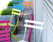 French Fermob slender recycled steel bistro sets are hugely popular. Around £250 for table and 2 chairs. www.fermob.com