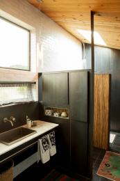 The kitchen is made from steel plate and timber