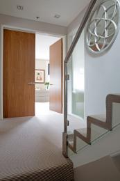 Double maple veneer doors in a London house by www.paulwarrendesign.com