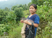 A young Nepali girl knits with nettle yarn. The Transrural Trust helps women in disadvantaged rural areas. www.transrural.org
