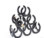 Horseshoes are upcycled into this six-bottle wine rack by Antony Dala, £80. www.makethemostof.co.uk