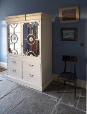A cream painted dresser by the front door