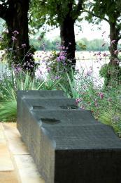 Ripple green oak bench with charred finish, £2,150, by www.chrisnanglefurniture.co.uk