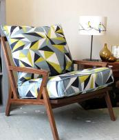 Bradbury walnut lounge chair in Elderberry Twill organic cotton from Lorna Syson. Chair £1,950. Fabric £79.99 per metre