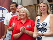 Catherine and the Bargain Hunt team. She says modern interiors can be enhanced by a few antiques, whether it's a mahogany desk or a Windsor chair. Photo courtesy of BBC Bargain Hunt