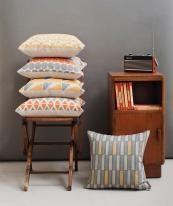Linen cushions in mid century modern geometric designs by Zoe Attwell, £50, www.zoeattwell.com