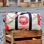 Weekend travel bag by Germany's Milchmeer. The material is made from waste cement bags and fish food bags. milchmeer.de