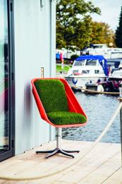 A plastic container, some offcuts of faux grass and the stand from an office chair and voila, a garden chair