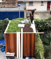 Getting the layers of green roof on - the product we used is Meadowmat
