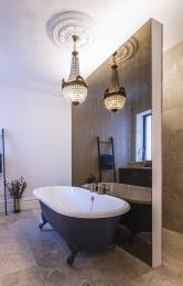 Bathrooms are rather luxurious with roll top baths.. well surely it'll short showers mostly and a once a month bathing indulgence in the tub